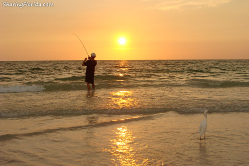 man fishing at a sunset